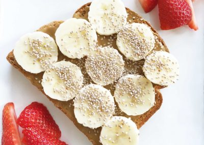 Bread toast with peanut butter, banana & chia seed.